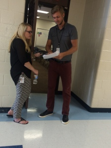 Amanda, 10th grade ELA teacher, and Jacob, 9th grade ELA teacher, discuss a student's essay.